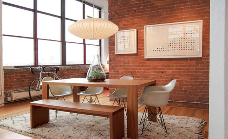 Artistic Dining Area With Brick Walls