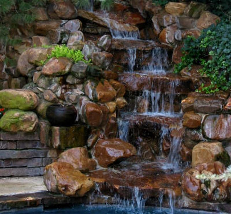 Relaxing backyard waterfalls ideas rilane for Stone garden waterfall