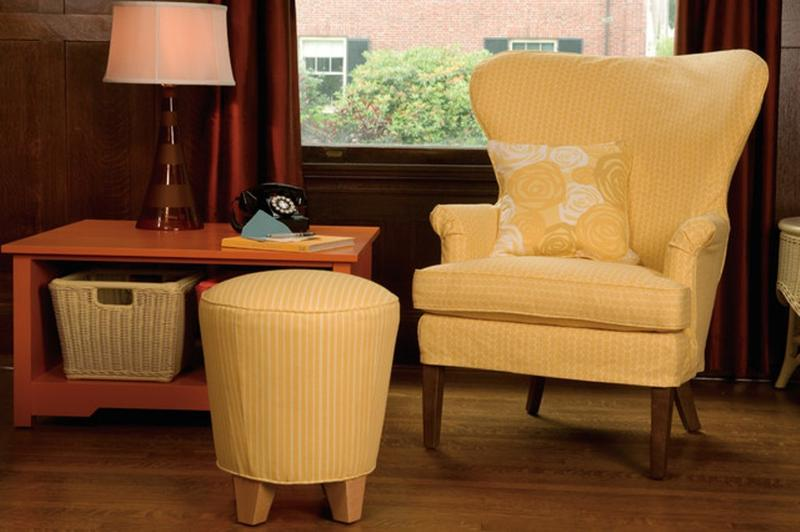 upholstered pastel yellow wingback chair