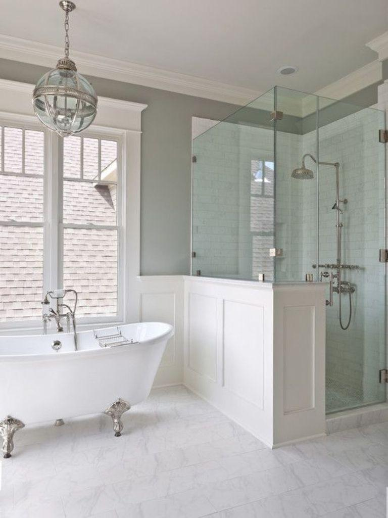 airy bathroom with white silver clawfoot bath tub - Bathroom Tub Ideas