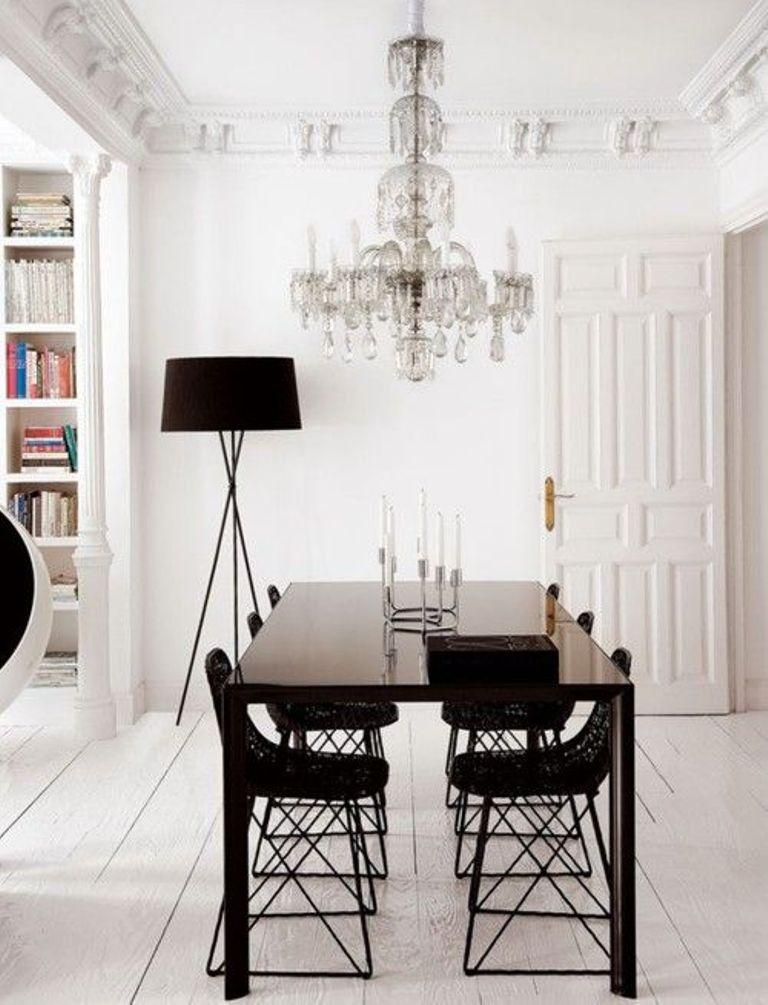 Black And White Dining Room With Beautiful Chandelier