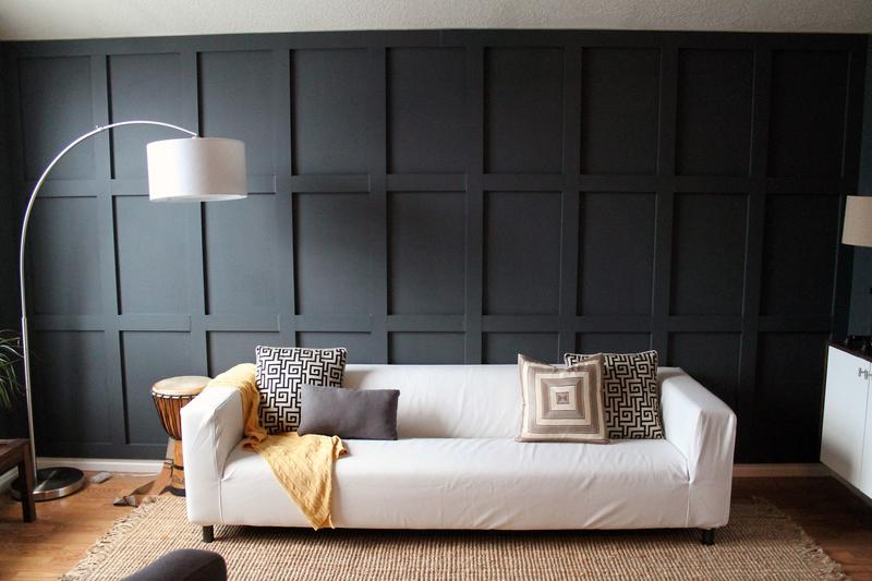 Chic Black Wood Panel Wall In A Contemporary Living Room