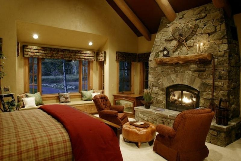 Exceptionnel Rustic Bedroom With Stacked Stone Fireplace