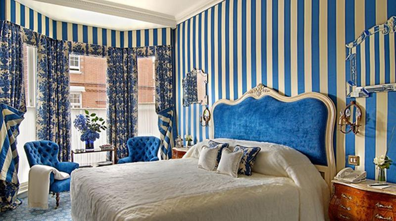 Chic Bedroom with Blue Striped Walls