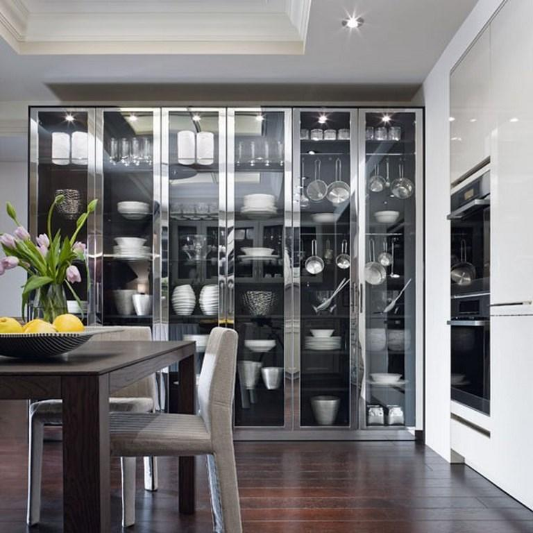 15 charming kitchen designs with glass cabinets rilane for Modern kitchen design aluminium