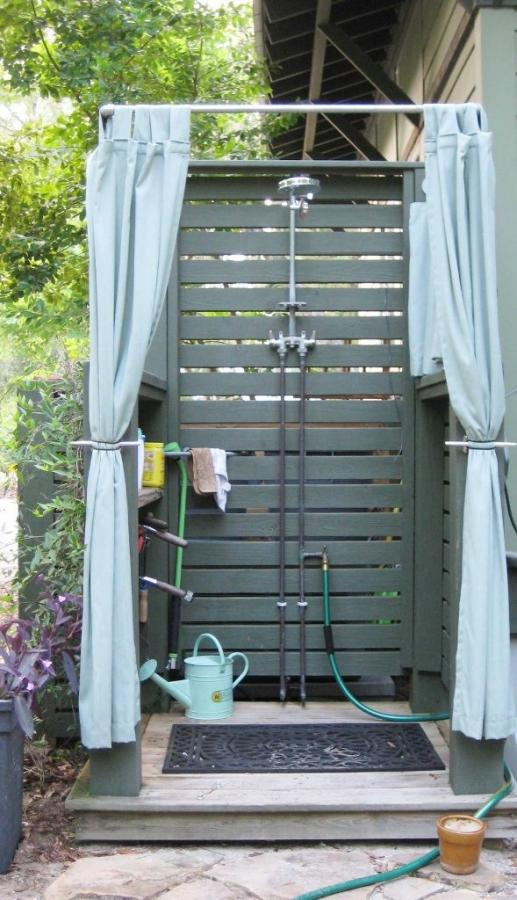 Blue Outdoor Shower With Curtains