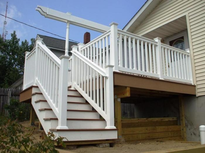 Amazing Deck With Stair For Exterior Decoration With White Wood Handrail