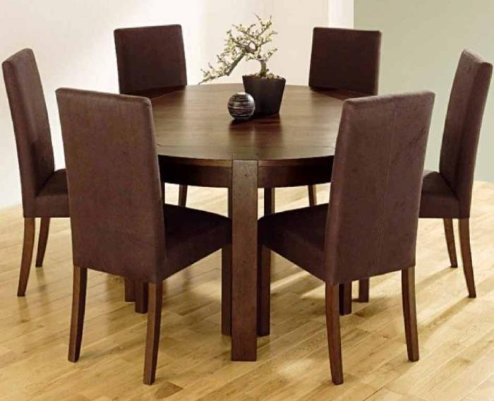 Dining Room With Leather Chairs And Round Wooden Table