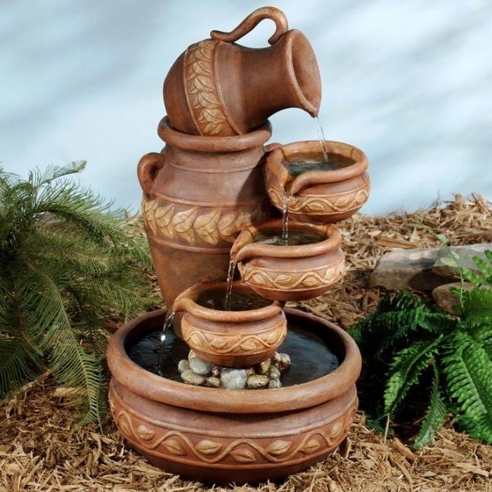10 relaxing and decorative outdoor water fountains rilane for Water fountain designs garden