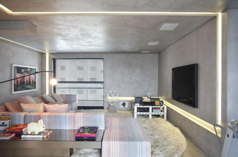 bright living room with concrete wall
