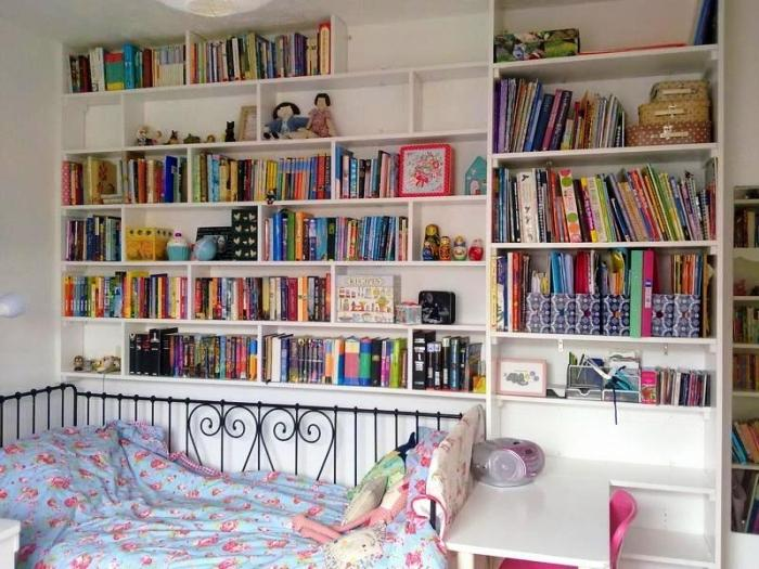 Pretty Girls Bedroom With Bookshelves