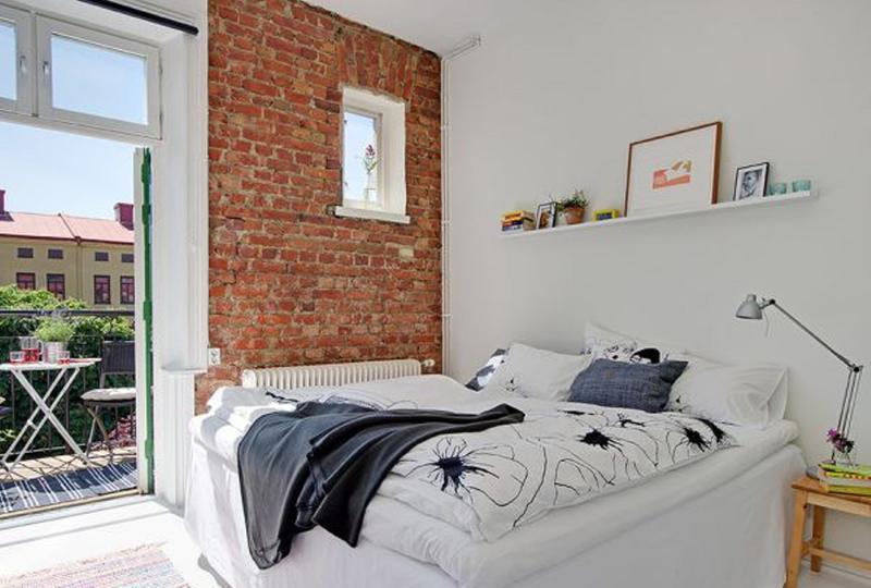 scandinavian bedroom with brick walls