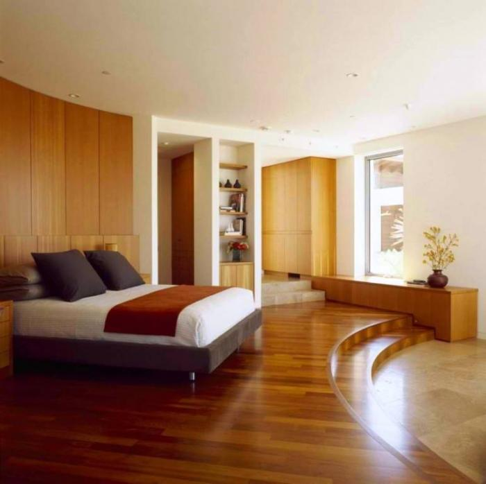 15 amazing bedroom designs with wood flooring rilane. Black Bedroom Furniture Sets. Home Design Ideas