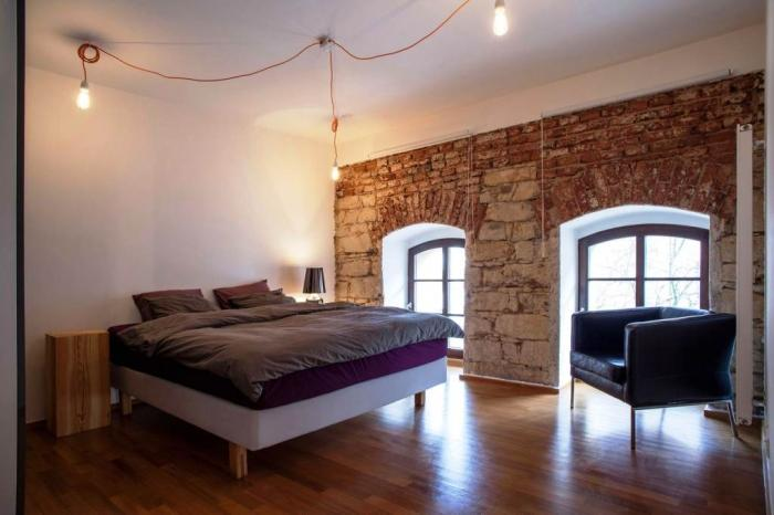 Modern Vintage Bedroom Design With Exposed Stone And Brick Wall Ideas Laminate Wooden Floor