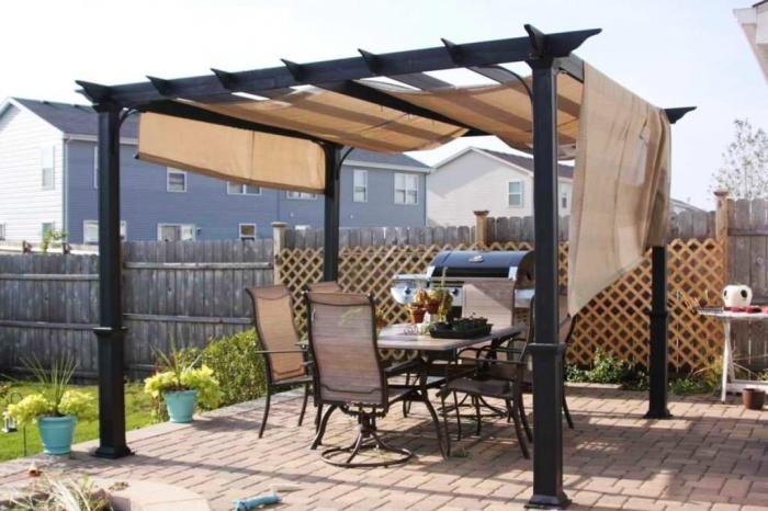 10 Relaxing and Comfortable Outdoor Canopy Designs Rilane : pergola canopy with canvas material and dark iron combined paving floor 700x466 from rilane.com size 700 x 466 jpeg 56kB