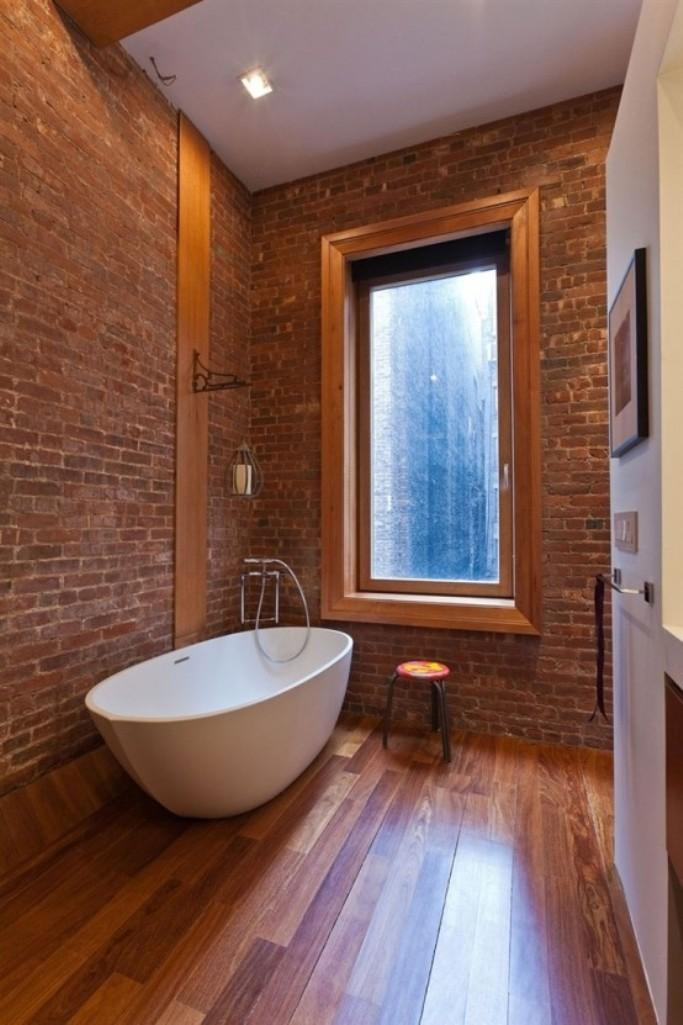 Bright Bathroom With Brick Walls
