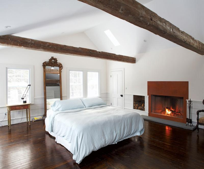 Bright Bedroom With Wood Beams