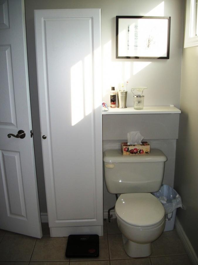 white wood over the toilet bathroom storage