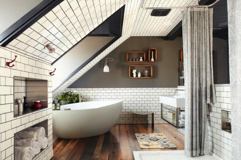 The white subway tiles, installed on the aesthetically advanced attic  walls. create crisp and urban feel in the natural and breezy bathroom.
