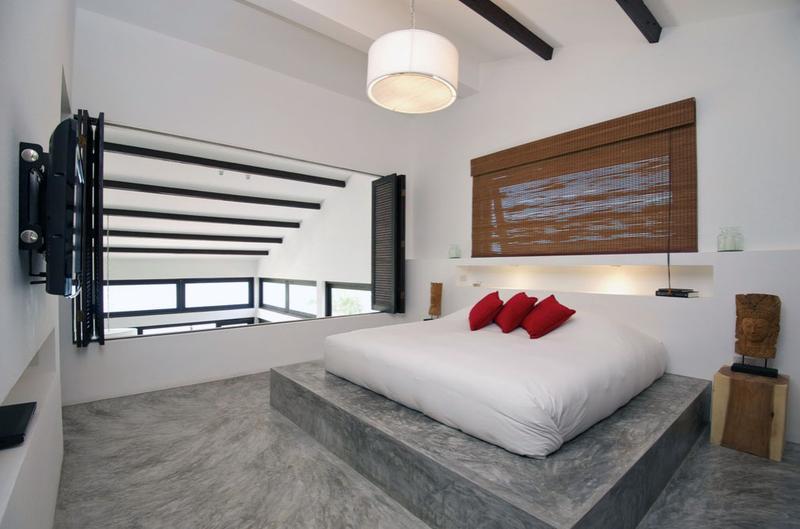 Bold Bedroom With Concrete Floor