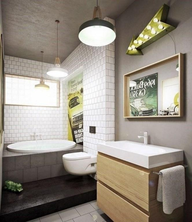 Bare concrete wall, enhanced by a subway tiled statement wall set the  extremely cool and industrial concept of this ultra modern bathroom.
