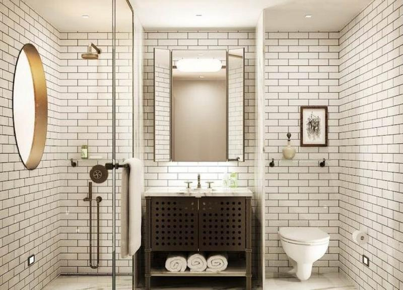 Clean And Crisp Outlook Is A Courtesy Of The White Subway Tiles That Bring The Traditional Charm And Cool Touch In The Beautiful Bathroom