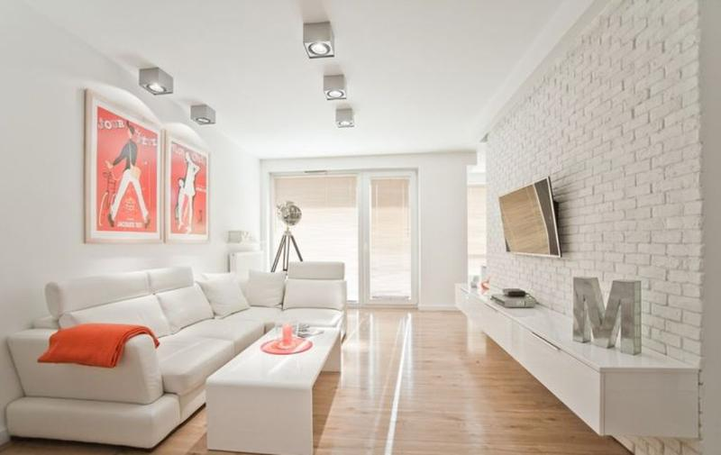 Vibrant Small Living Room Idea. All White Color Scheme With Pops Of Orange  Create A Bold And Refreshing Appearance In The Small Space Decorated In A  Really ...