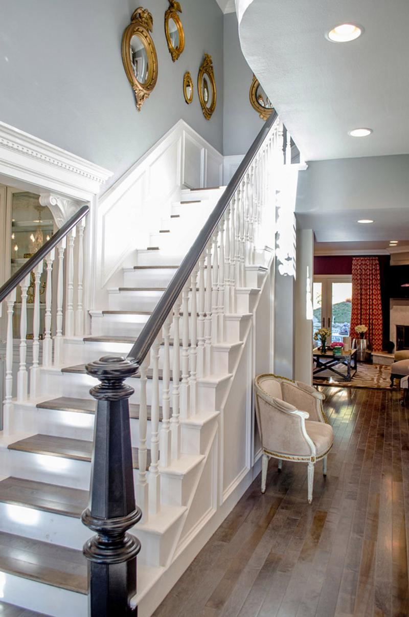 White Stairs Leading To The Second Floor Mirrors