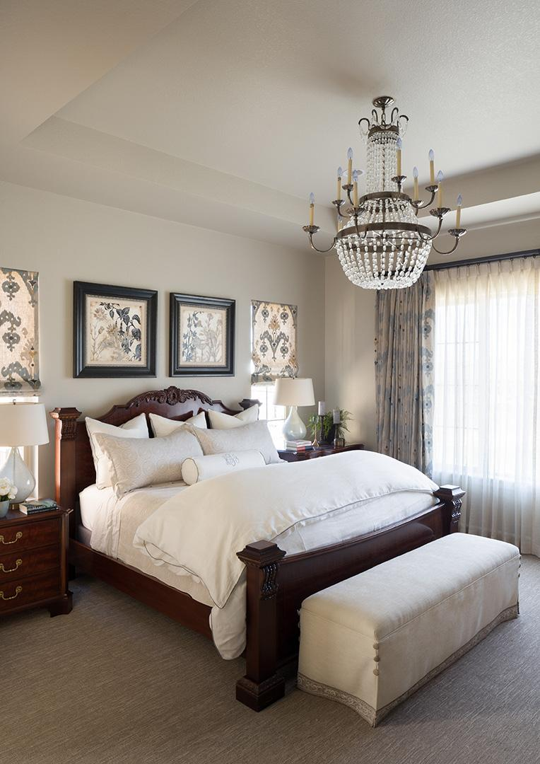 Bedroom With A Large Chandelier